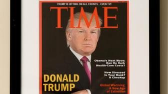 DORAL, FL - JUNE 24:  Framed portrait of President Donald Trump on the cover of a TIME Magazine and other magazine covers framed and hanging from a wall at the Trump National Doral Miami Golf Shop, in Doral, Florida June 24, 2017. (Photo by Angel Valentin for The Washington Post via Getty Images)
