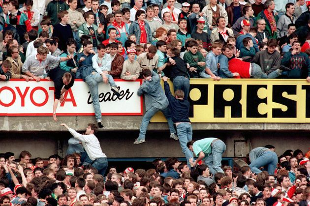 Fans try to get away from the crush of the crowd during the Hillsborough disaster in