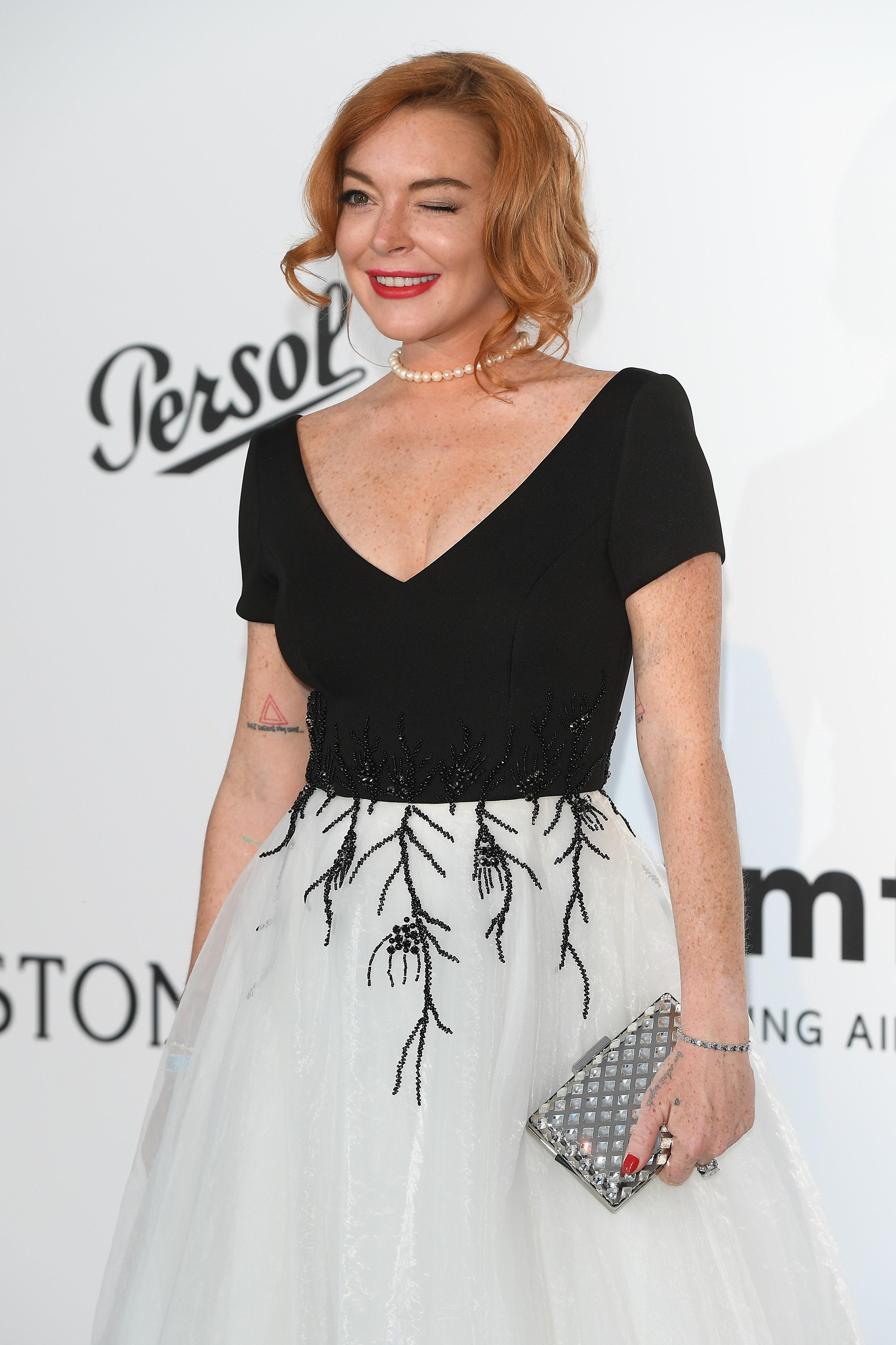 CAP D'ANTIBES, FRANCE - MAY 25:  Lindsay Lohan arrives at the amfAR Gala Cannes 2017 at Hotel du Cap-Eden-Roc on May 25, 2017 in Cap d'Antibes, France.  (Photo by Venturelli/WireImage for amfAR)