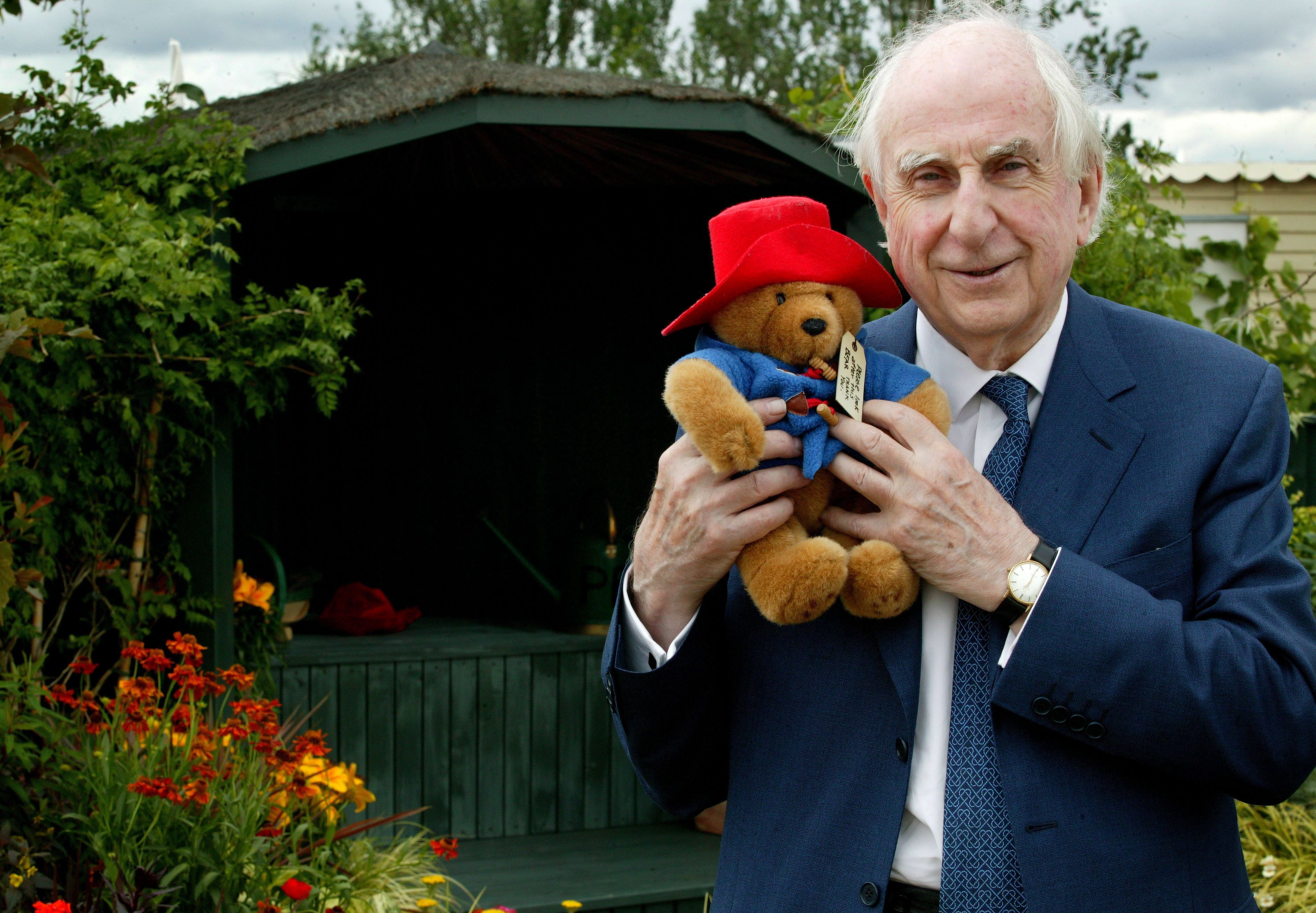 The Hampton Court Palace Flower Show 2005 Press day, Hampton Court Palace, London, Author of the Paddington Bear books, Michael Bond, in the Action Medical Research garden. (Photo by Avery Cunliffe/Photoshot/Getty Images)