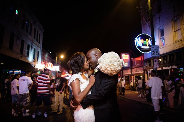 """""""Eric and Erica united as husband and wife as the sun set over Memphis' historic Court Square park. The newlyweds danced and"""