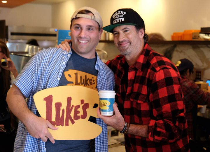 Scott Patterson holding a cup of Luke's coffee.