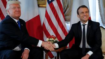 U.S. President Donald Trump (L) and French President Emmanuel Macron shake hands before a working lunch ahead of a NATO Summit in Brussels, Belgium, May 25, 2017.  REUTERS/Jonathan Ernst