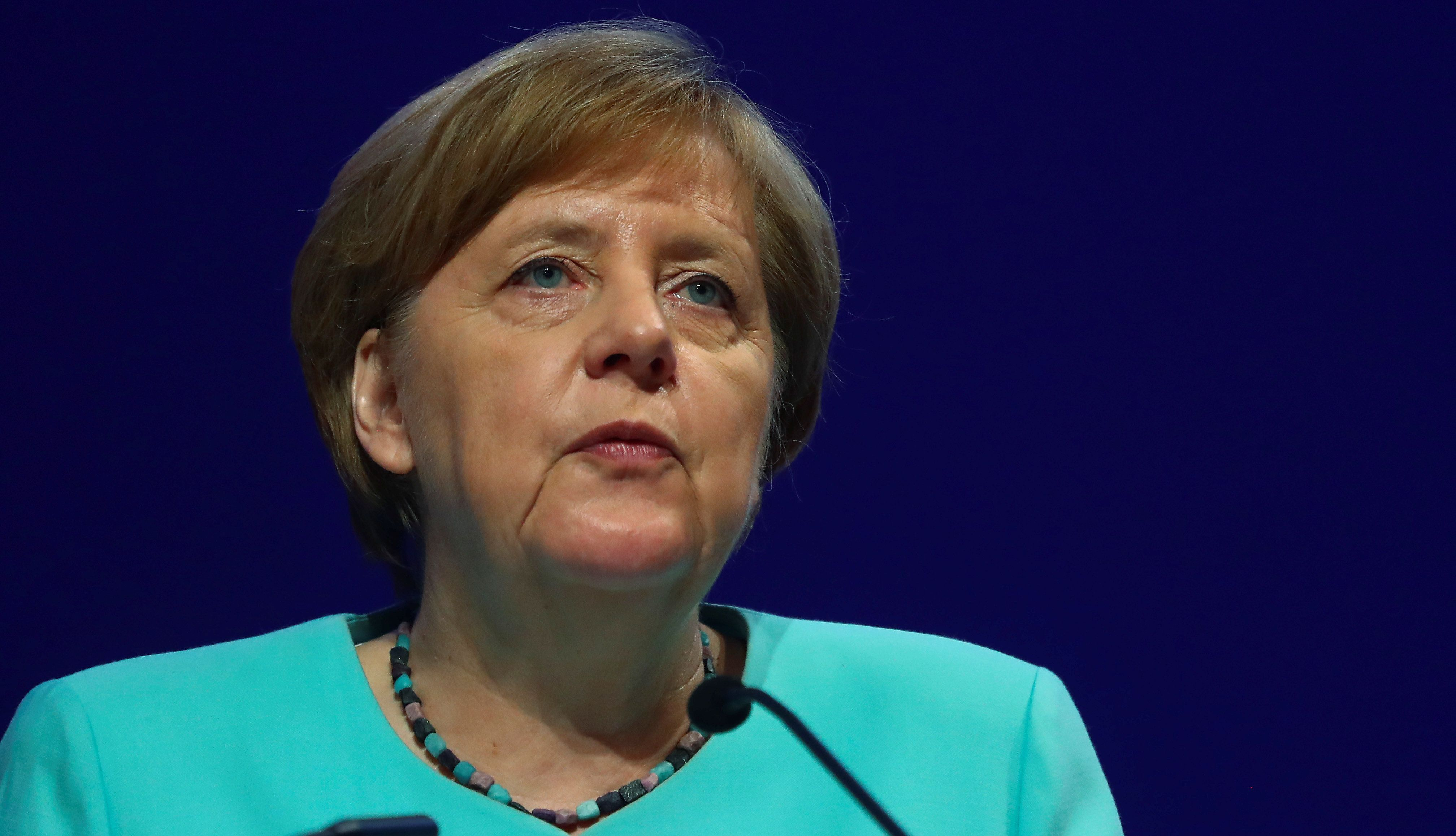 Angela Merkel says a visit to a lesbian couple changed her stance on gay