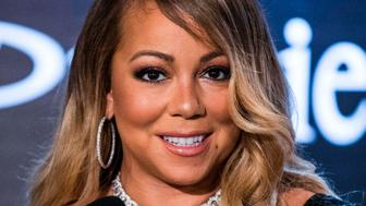 CORRECTION - US Singer Mariah Carey speaks at a press conference to announce an agreement with Israeli cosmetics brand Premier Dead Sea, in the coastal city of Tel Aviv on June 26, 2017. / AFP PHOTO / JACK GUEZ / The erroneous mention[s] appearing in the metadata of this photo by JACK GUEZ has been modified in AFP systems in the following manner: [Dead Sea] instead of [Red Sea]. Please immediately remove the erroneous mention[s] from all your online services and delete it (them) from your servers. If you have been authorized by AFP to distribute it (them) to third parties, please ensure that the same actions are carried out by them. Failure to promptly comply with these instructions will entail liability on your part for any continued or post notification usage. Therefore we thank you very much for all your attention and prompt action. We are sorry for the inconvenience this notification may cause and remain at your disposal for any further information you may require.        (Photo credit should read JACK GUEZ/AFP/Getty Images)