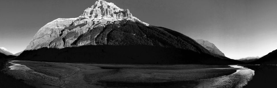 """Andrew McCausland. Abbotsford BC, Canada. <strong>2nd Place –Panorama.<br /></strong><br />""""<i>This picture was taken in the Yoho National Park of Canada just outside of Field, BC on October 12, 2016. I was traveling to Banff from Vancouver and the sun was disappearing over the mountains and I was compelled to stop and capture the Majestic mountain in the fading light.""""</i>"""