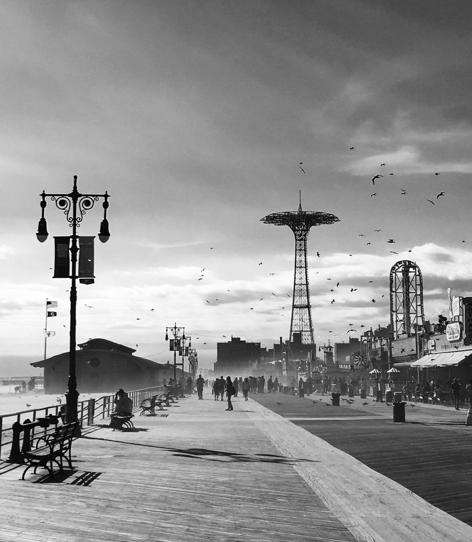 """Maria K. Pianu. Pordenone, Italy.<strong>3rdPlace –</strong><strong>The America I Know.</strong><br /><br /><br /><i>""""When in NY area, I like to take an out of season walk in Coney Island.This photo was taken during an Indian summer windy day, breathing the Ocean breeze and getting inspired by Coney Island decadent and old-school Brooklyn atmosphere.""""</i>"""