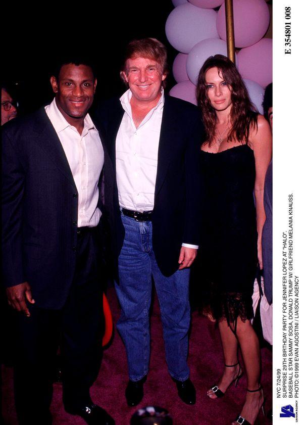 With baseball star Sammy Sosa and Melania Knauss at Jennifer Lopez's30th birthday partyin New York City.