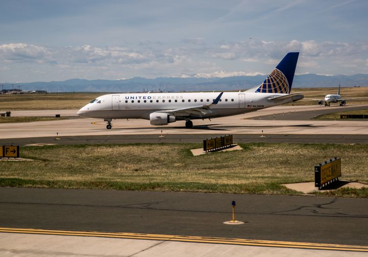 A baby reportedly overheated after sitting on a United Airlines flight that was delayed at Denver International Airport.