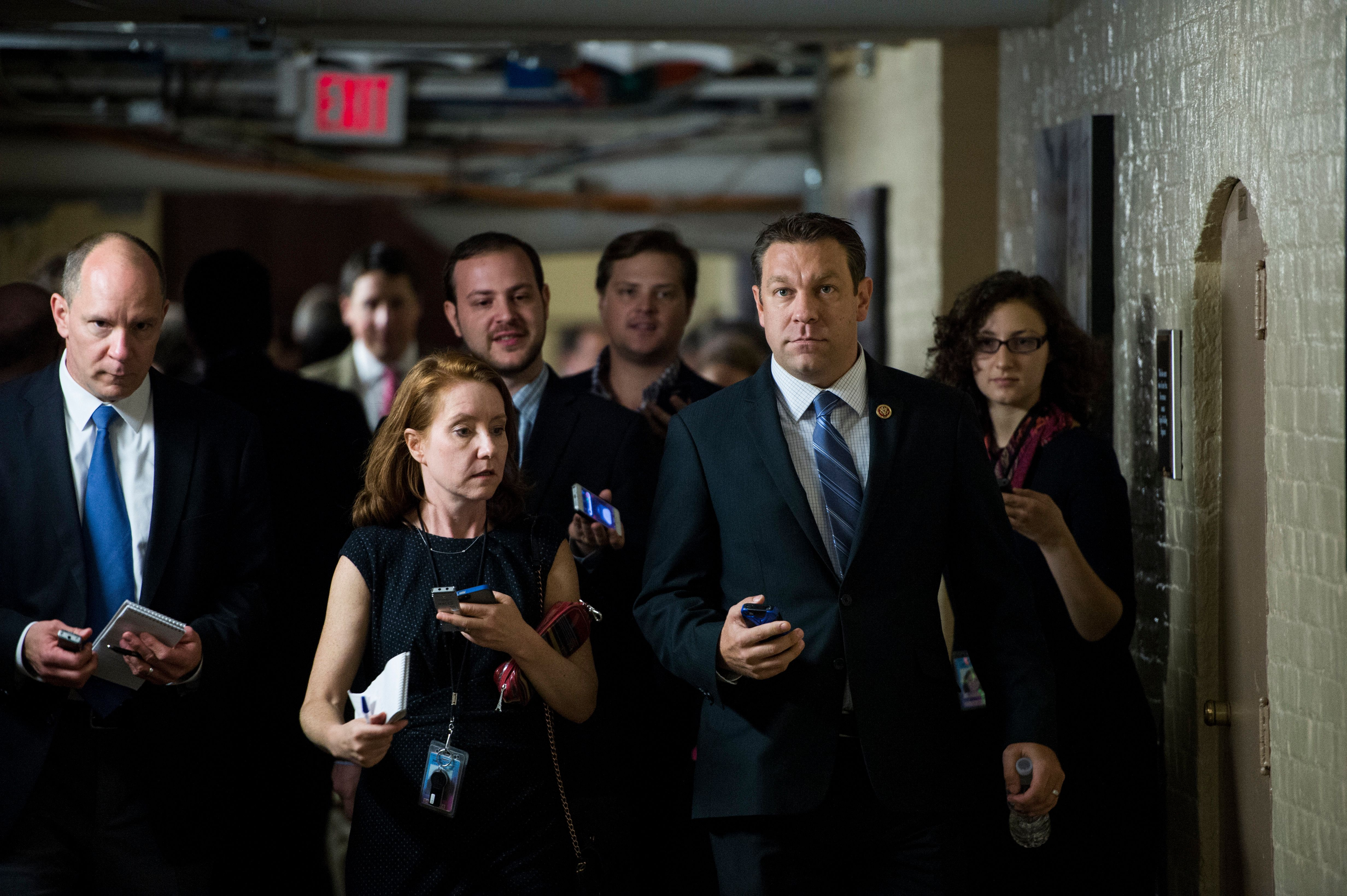 UNITED STATES - OCTOBER 4: Rep. Trey Radel, R-Fla., speaks with reporters as he leaves the House Republican Conference meeting in the basement of the Capitol on Friday, Oct. 4, 2013.  (Photo By Bill Clark/CQ Roll Call)