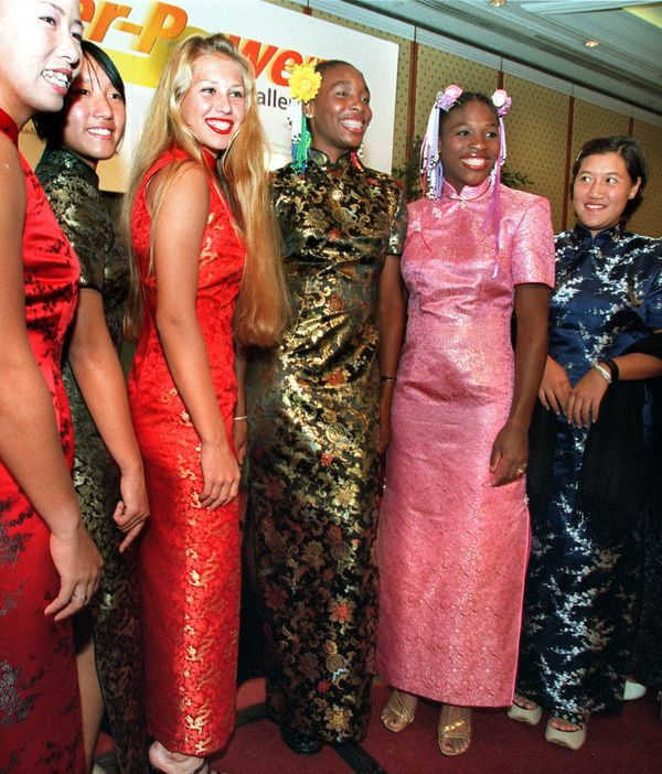 Wearingtraditional Chinese dresses, called cheongsam, at the players' party for the Super Power Challenge Cup on Jan. 6