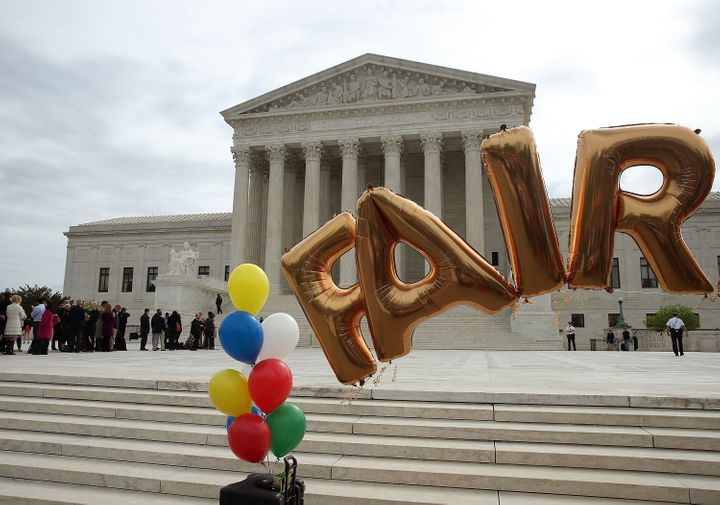 Balloons set up in front of the U.S. Supreme Court on April 19, the day the high court heard oral arguments in the Trinity Lu