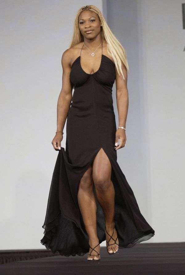 Walking inthe Super Bowl XXXVI Gridiron Glamour Celebrity Fashion Show in New Orleans on Feb. 2, 2002.