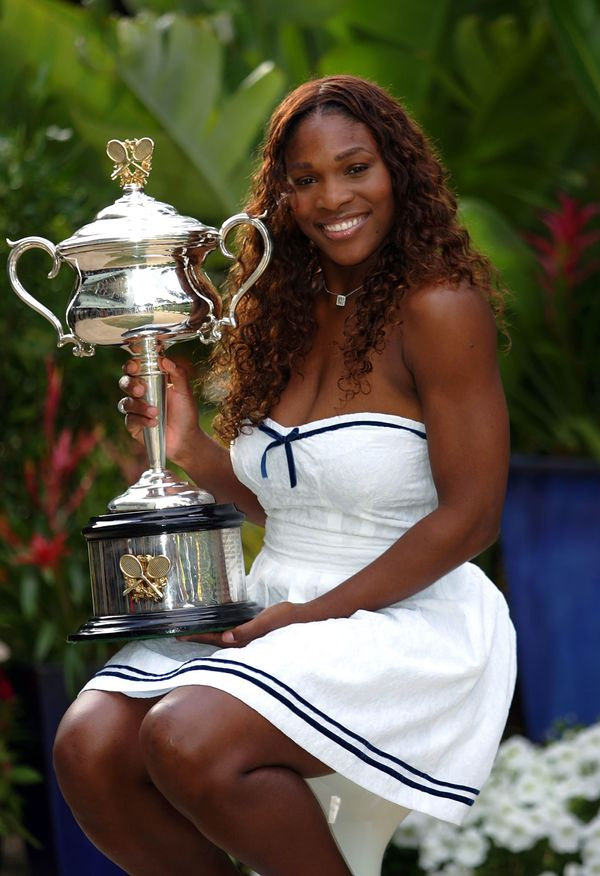 Posingwith the trophy in the players' garden after winning the Australian Open women's final match against Maria Sharap
