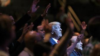 LAS VEGAS, NV - OCTOBER 30:  Republican presidential nominee Donald Trump attends a worship service at the International Church of Las Vegas October 30, 2016 in Las Vegas, Nevada. With nine days to go before Election Day, Trump is hoping to inspire the GOP base, including evangelical Christians, to support him.  (Photo by Chip Somodevilla/Getty Images)