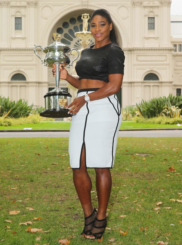 Holdingthe Daphne Akhurst Memorial Cup during a photocall after winning the 2015 Australian Open on Feb. 1, 2015, in Me