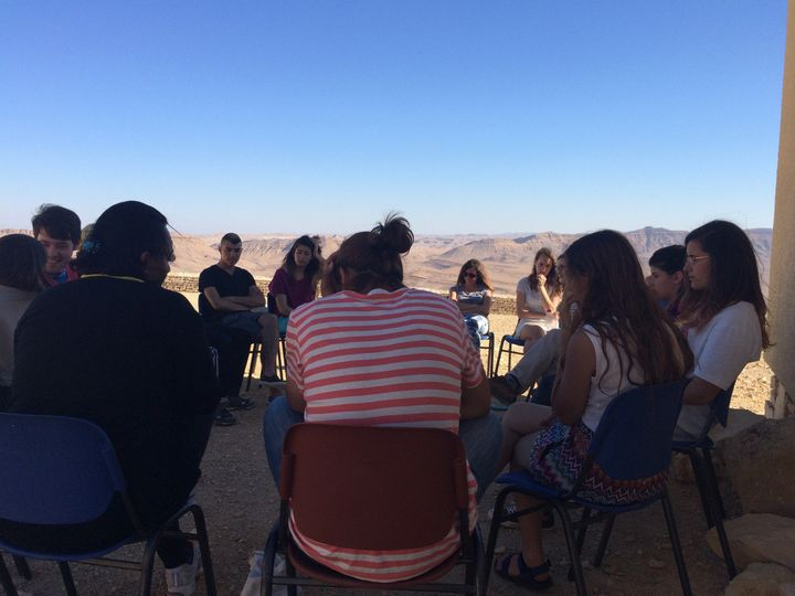 Jerusalem Youth Chorus members engaging in facilitated dialogue.