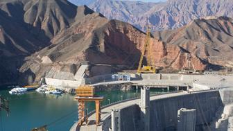JIANZHA COUNTY, CHINA - NOVEMBER 23: The dam of the Lijiaxia Hydropower Station at the Kanbula Township on November 23, 2011 in Jianzha County of Qinghai Province, China. Lijiaxia Hydropower Station, located at the Lijiaxia Gorge of the Yellow River trunk stream, was built in 1995 and is the world's largest hydrostation installed with double-row hydrogenerator units, with an annual average generating capacity of 5.9 kilowatts per hour. (Photo by China Photos/Getty Images)