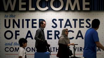 International passengers arrive at Washington Dulles International Airport after the U.S. Supreme Court granted parts of the Trump administration's emergency request to put its travel ban into effect later in the week pending further judicial review, in Dulles, Virginia, U.S., June 26, 2017. REUTERS/James Lawler Duggan     TPX IMAGES OF THE DAY