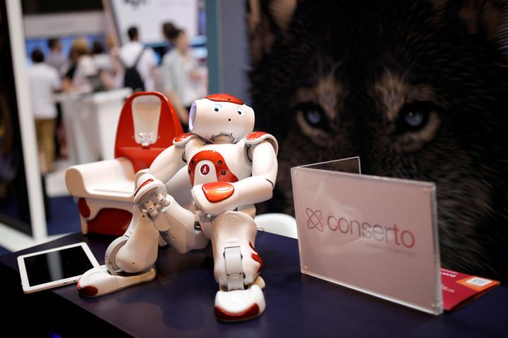A 'NAO' humanoid robot, manufactured by SoftBank Group Corp., is displayed at the Viva Technology conference in Paris, Franc