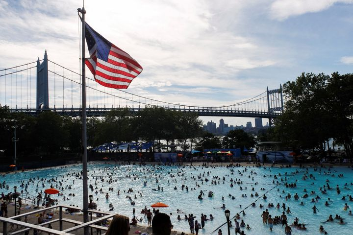 People enjoy a day in the pool during a heat wave in the Queensborough of New YorkCity, July 24, 2016.
