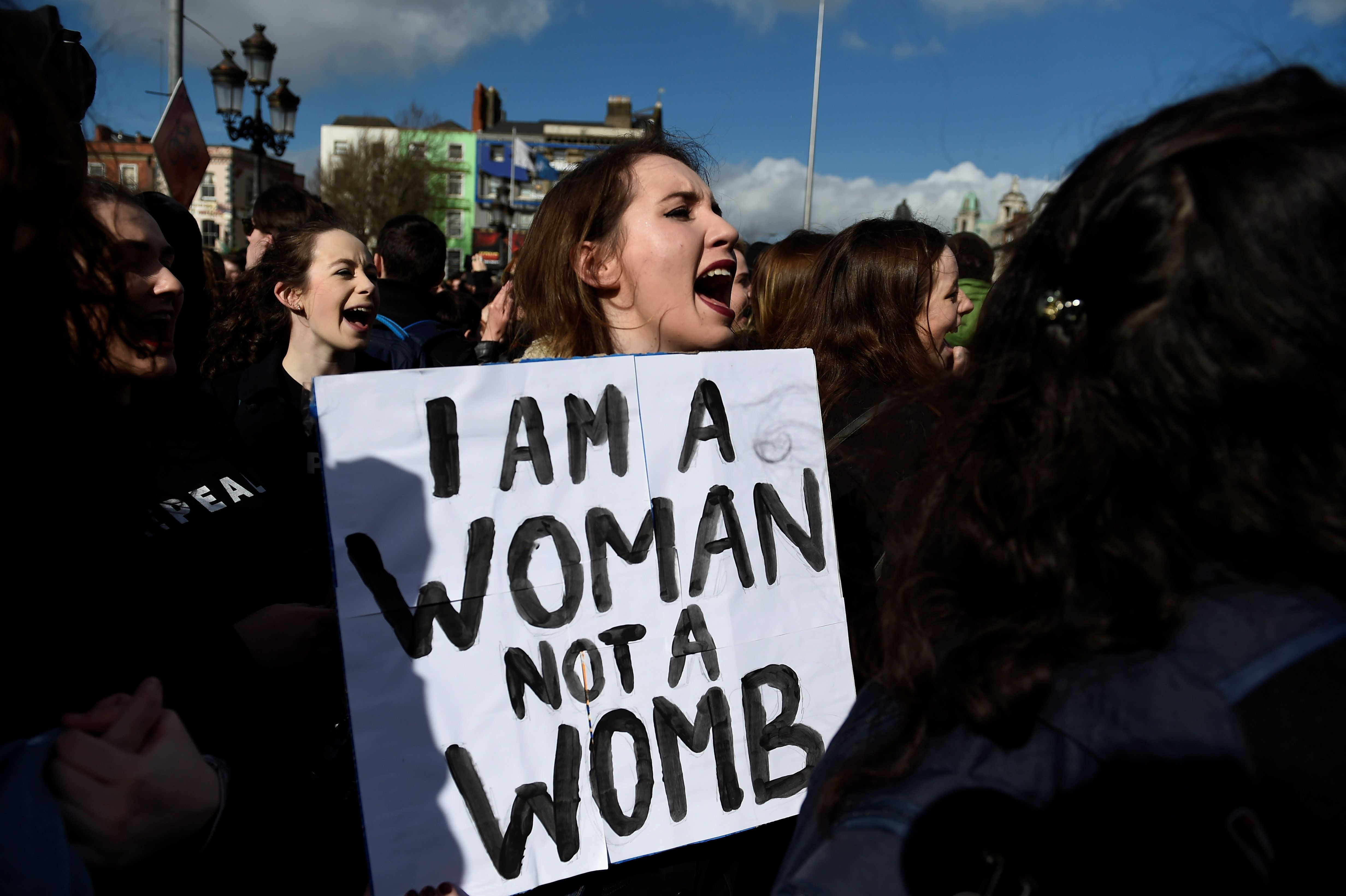 A woman protests in Dublin in March against Ireland's harsh abortion restrictions.
