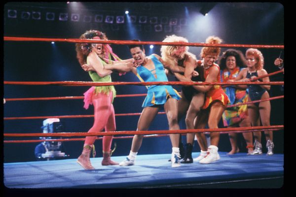 Members of the GLOW Girls wrestle in the ring in Los Angeles, CA on May 4, 1988. Jacqueline Stallone manages the all-female w