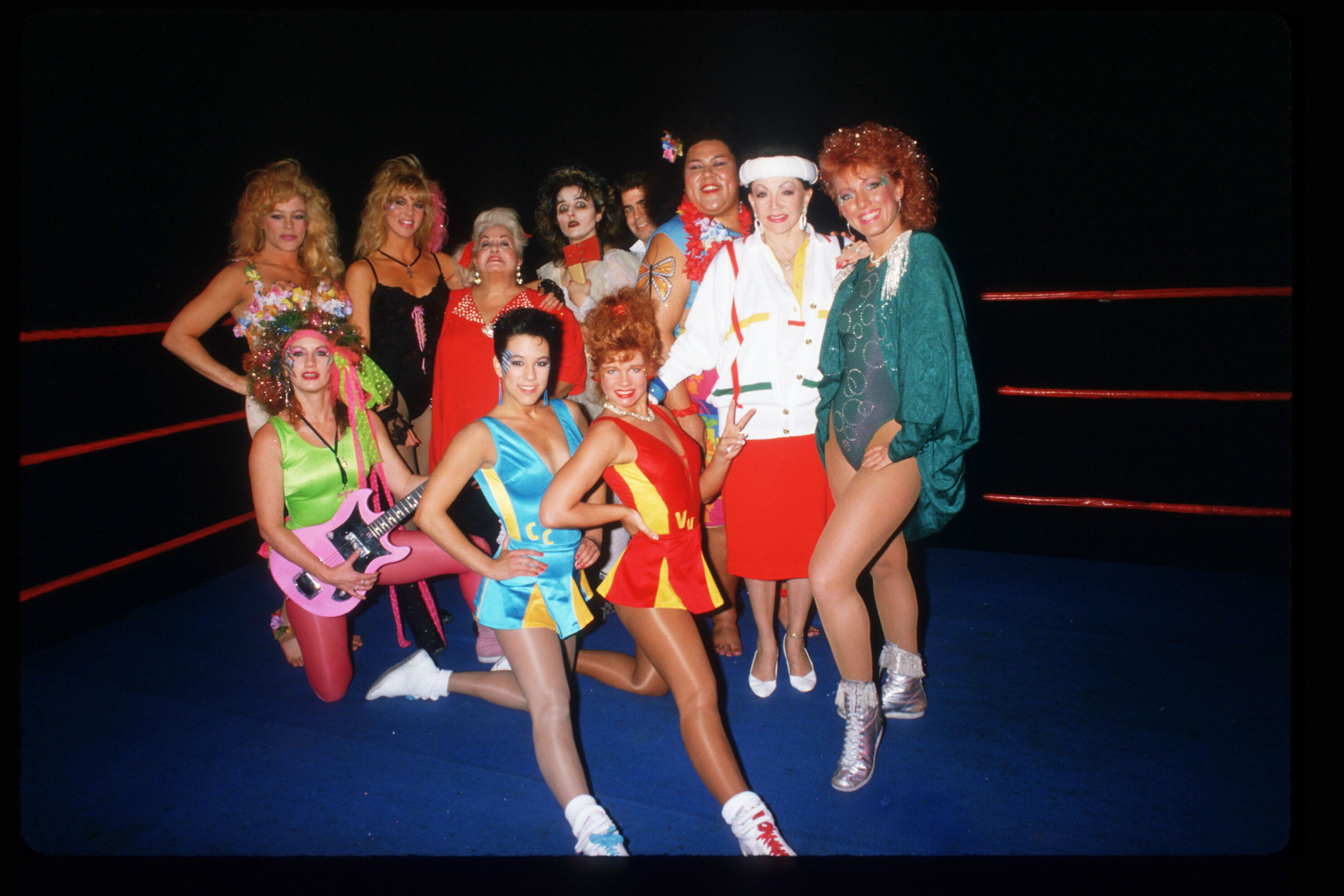 Members of the GLOW Girls pose in the ring.