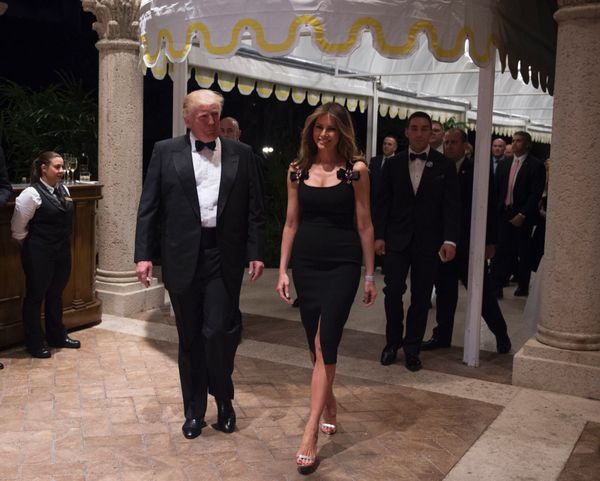 With Melania Trump at a New Year's Eve Party at the Mar-a-Lago estate in Palm Beach, Florida.