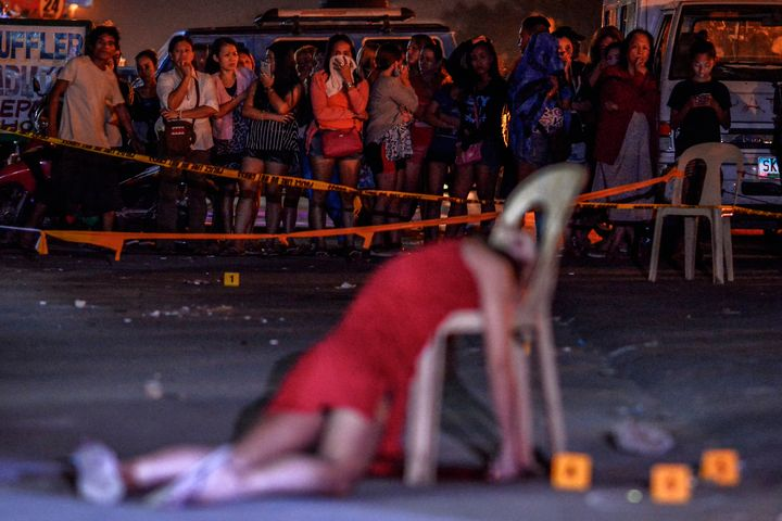 The body of Cristita Padual is slumped on a chair after she was shot dead by unknown assailants in Quezon city, north of Mani