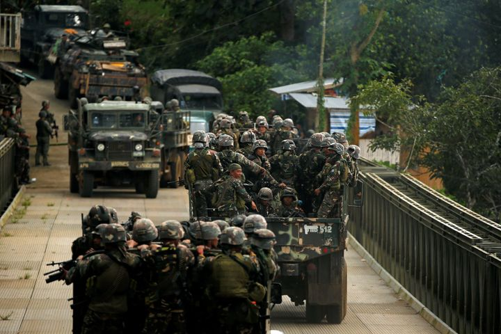Philippines army soldiers ride in trucks into the fighting zone in the city of Marawi.