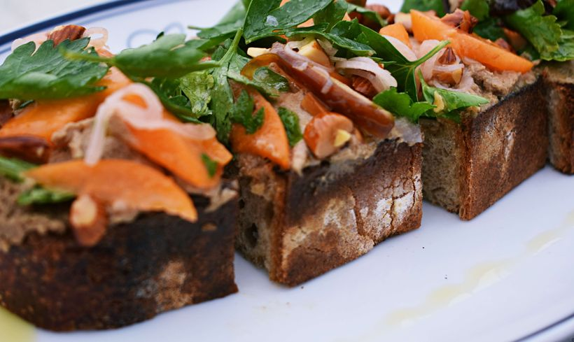 Catania's duck liver mousse on country bread with seasonal garnishes