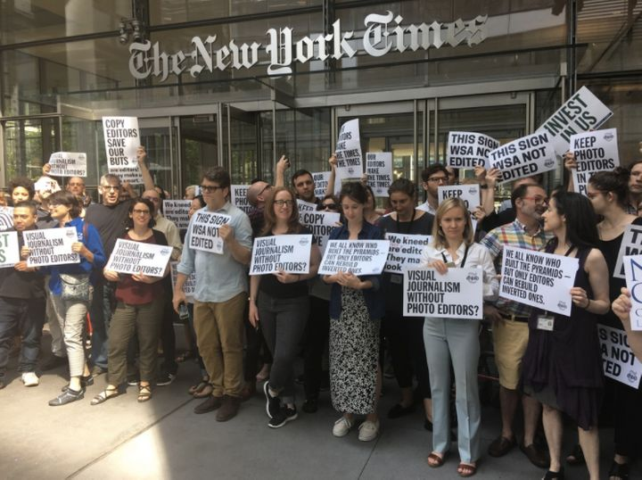 Dozens of New York Times employees stage a walkout after cuts to the publication's copy desk were announced.