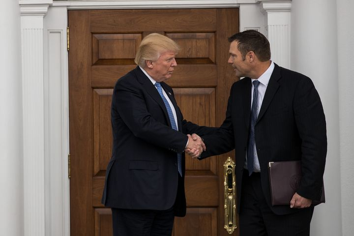 Then-President-elect Donald Trump and Kris Kobach, Kansas secretary of state, shake hands following their meeting at Trump In