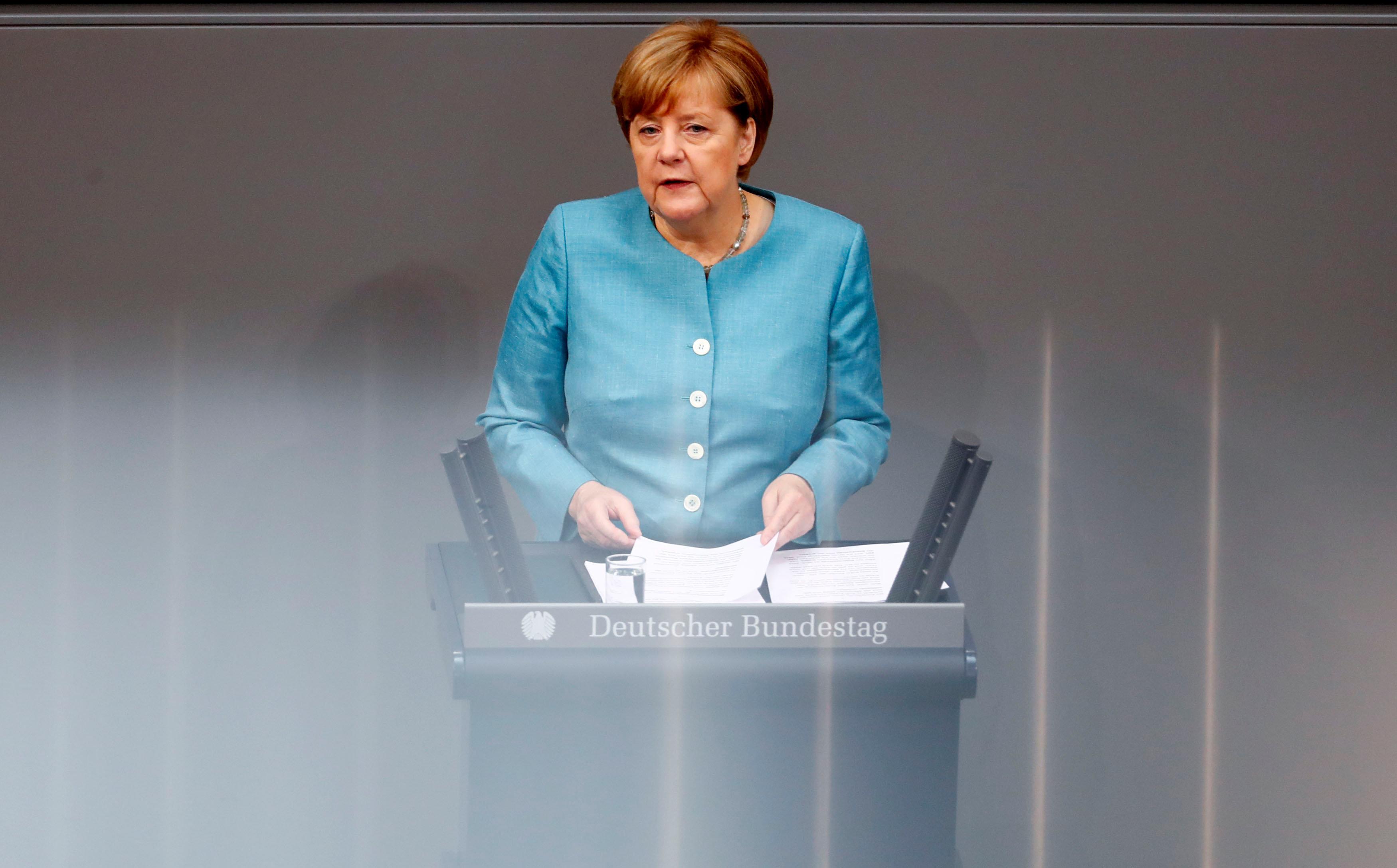 German Chancellor Angela Merkel addresses the lower house of parliament.