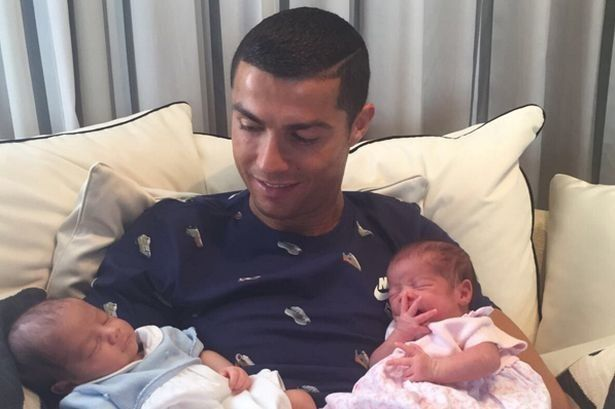 Cristiano Ronaldo cuddles his newborn twins