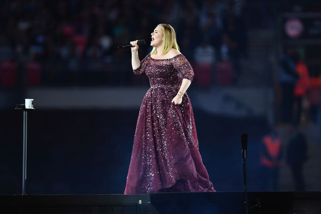 Adele on stage at Wembley Stadium, probably not swearing