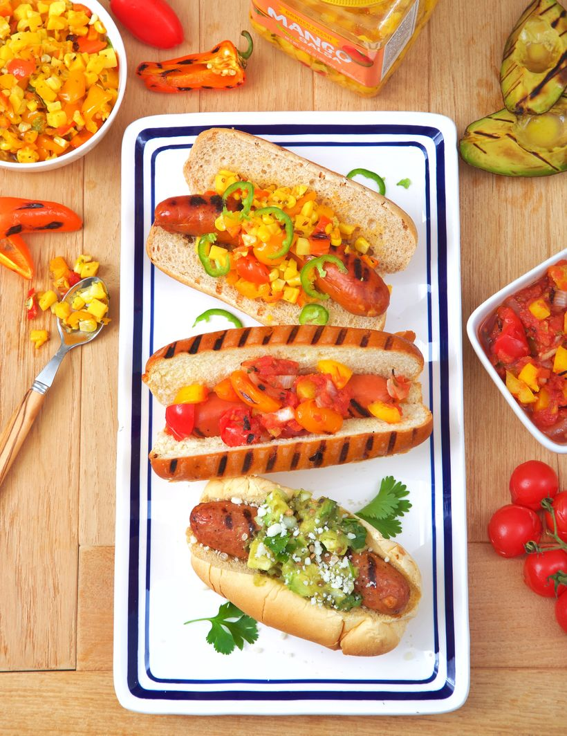 <em>From top to bottom:  Mango, Sweet Pepper & Corn Relish on Chorizo; Cherry Tomato, Yellow Pepper & Red Onion Relis
