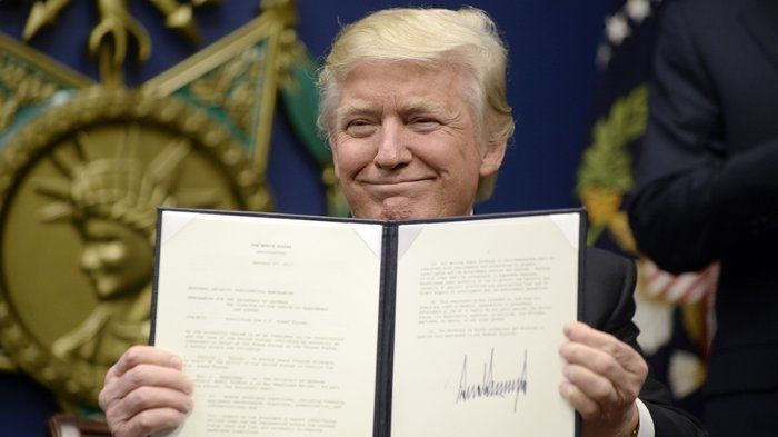 Trump signs Executive Order banning  immigrants from 7 predominately Muslim countries.