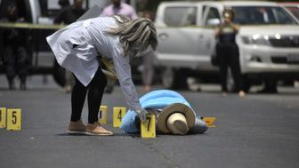 The body of Mexican journalist Javier Valdez lies on the street after he was shot dead in Culiacan, Sinaloa, Mexico, on May 15, 2017. Valdez, 50, who worked for Agence France-Presse and other media, was shot near the premises of one of the Mexican news outlets he worked for in the city of Culiacan in Mexico's violent Sinaloa state. Valdez was the fifth journalist to be killed this year in a country plagued by violence related to drug gangs, according to officials and media rights groups.  / AFP PHOTO / FERNANDO BRITO        (Photo credit should read FERNANDO BRITO/AFP/Getty Images)