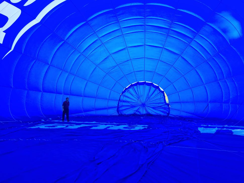 The balloon is huge - as can be seen by the pilot checking the inside before lift-off.