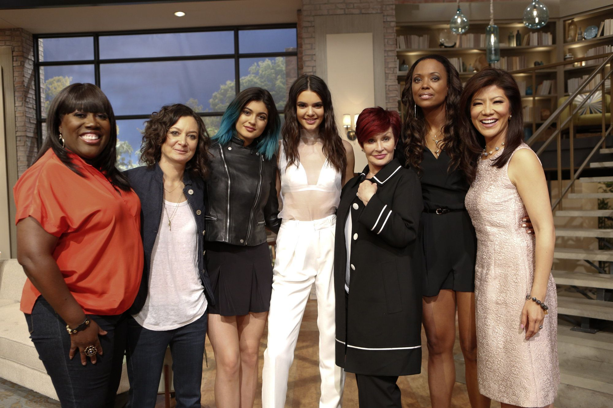 LOS ANGELES - JUNE 12: Reality stars and authors Kendall and Kylie Jenner discuss their new book on THE TALK Friday, June 13, 2014 on the CBS Television Network. From left, Sheryl Underwood, Sara Gilbert, Kylie Jenner, Kendall Jenner, Sharon Osbourne, Aisha Tyler and Julie Chen, shown. (Photo by Cliff Lipson/CBS via Getty Images)