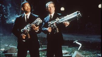 1997 J (Will Smith) and K (Tommy Lee Jones) take aim at an alien in the sci-fi action comedy, 'Men In Black'.