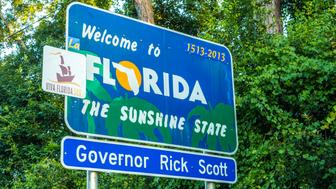 Pensacola, Florida - July 18, 2013: Welcome sign to the state of Florida in Pensicola, USA. The area is ruled by Governor Rick Scott.