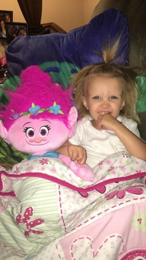 Phoebe Brasswell was born with a rare condition that makes her hair uncombable Her nickname is Poppy after a character in the movie Trolls