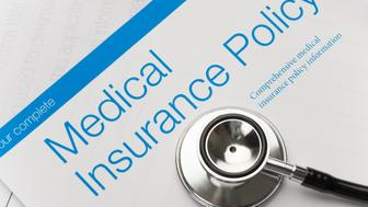 Health Insurance Policy brochure with stethoscope