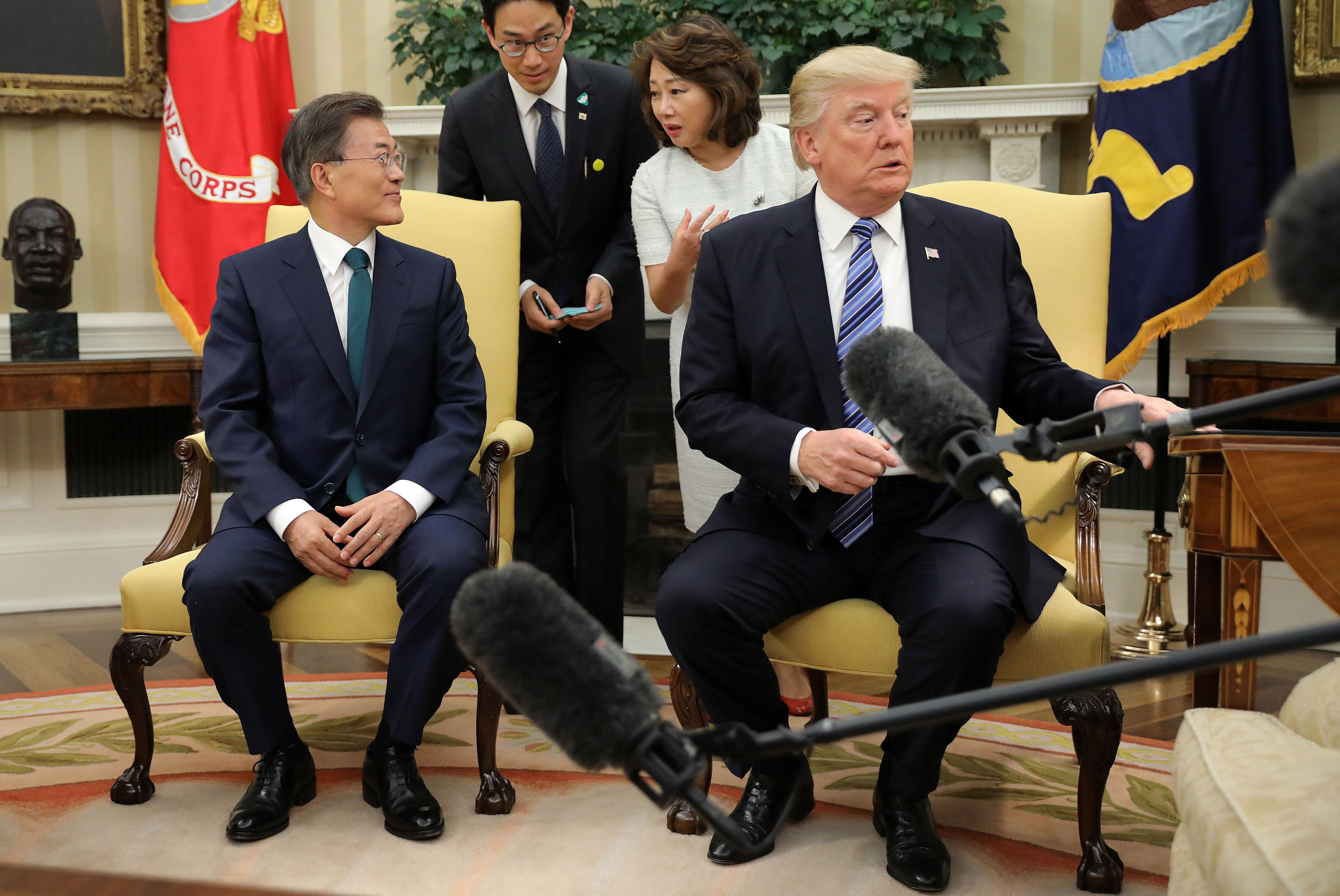 REFILE-ADDING INFORMATION U.S. President Donald Trump reacts after a lamp next to him was almost turned over during a photo spray with South Korean President Moon Jae-in in the Oval Office at the White House in Washington, U.S., June 30, 2017. REUTERS/Carlos Barria