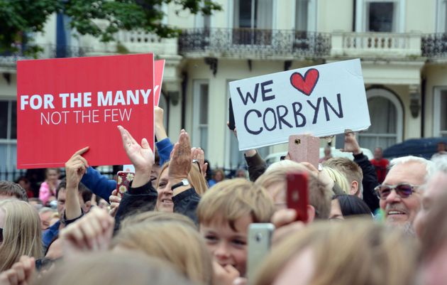 Supporters wave banners as Corbyn addresses a rally in Warrior Square