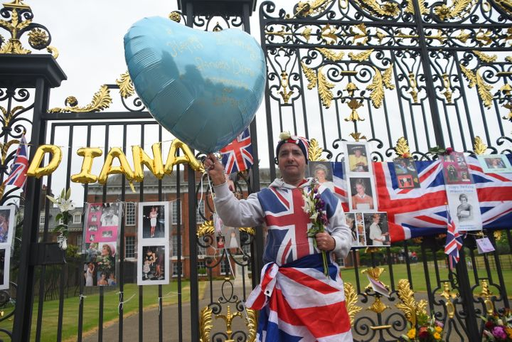 Visitors left balloons, flags and photos at Kensington Palace, where Princess Diana once lived.