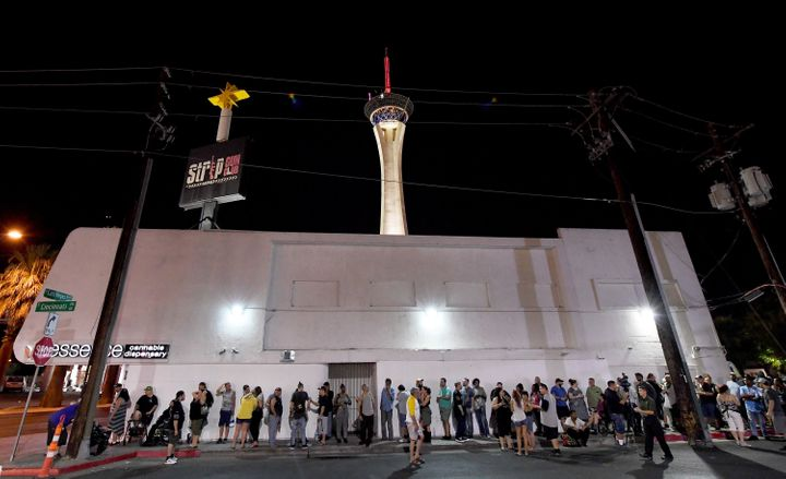 Customers line up in Las Vegas Friday evening as they wait for recreational marijuana sales to begin.